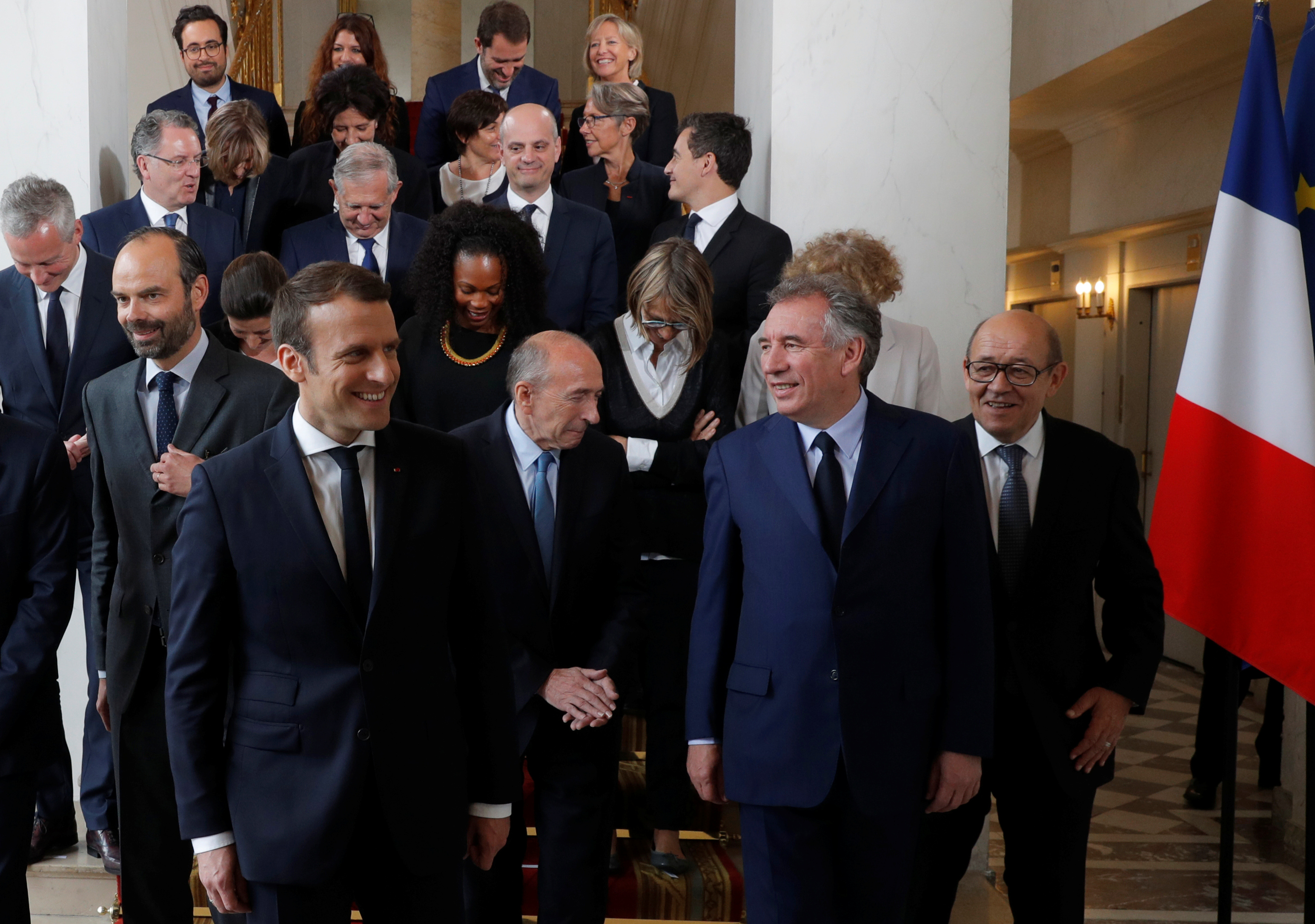 Sourires d'Emmanuel Macron, François Bayrou, Jean-Yves Le Drian après la photo de famille